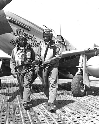 Marston Mat - 332nd Fighter Group pilots discuss combat flying. Walking on Marsden matting.