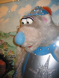 Basil the Bear from Canada's Sesame Park, in a knight's armour. The puppet, as well as most of the series cast, is displayed at the CBC Museum.