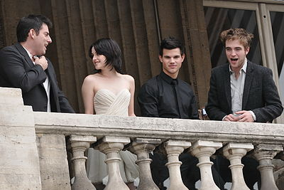 The 2008 drama/romance film Twilight was a blockbuster success. (Pictured on the right are the film's stars Kristen Stewart, Taylor Lautner and Robert Pattinson.) Twilight 20091110 Crillon Hotel Paris 003.jpg