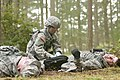 U.S. Army 1st Lt. Sophia Tripop a nurse with the 47th Combat Surgical Hospital, checks for blood and injuries on a casualty as part of the training lane for the Expert Field Medic Badge at Joint Base 130409-A-CD114-326.jpg