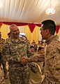 U.S. Army Maj. Gen. Robert Catalanotti, left, shakes hands with Navy Lt. Jisup Choi, a chaplain, during his visit with Marines and Sailors assigned to the Marine Corps 26th Marine Expeditionary Unit who are 130429-M-HF949-001.jpg
