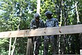 U.S. Army Pfc. Ryan Lambert and Spc. Chris Edwards, both with 1194th Engineer Company, Ohio Army National Guard, mark a board to prepare it for trusses during Homeland Response Force at the Camp Ravenna Joint 130723-A-EU423-980.jpg