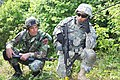 U.S. Army Spc. Parminderjeetsingh Virk, right, with the 2nd Cavalry Regiment, and an Albanian soldier take part in an assault training exercise during the Immediate Response 2012 training event June 6, 2012 120606-A-OD503-020.jpg