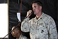 U.S. Marine Corps Staff Sgt. Dustin Reel, a joint terminal attack controller and team chief with the 1st Air Naval Gunfire Liaison Company, radios confirmation of enemy presence and calls for close-air support 131002-F-WU507-256.jpg