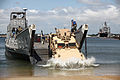 U.S. Marines from Combat Logistics Battalion 8, Transportation Support Company, work together with Navy personnel from Beach Master Unit 2 off-loading ISO containers off a Landing Craft Utility during 120615-M-KS710-129.jpg