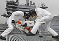 U.S. Navy Aviation Boatswain's Mate (Handling) Airmen Sean Phillips and Cody Willows cut a grate on the flight deck of the aircraft carrier USS Nimitz (CVN 68) 130130-N-KE148-171.jpg