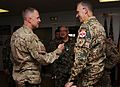 U.S. Navy Capt. Barth Merrill, left, the commander of the Kandahar Regional Medical Hospital, welcomes German army Brig. Gen. Juergen Brandenstein, right, the command surgeon of the International Security 130819-A-VM825-002.jpg