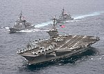 USS Carl Vinson and Japan ships transit the Philippine Sea. (33445536944).jpg