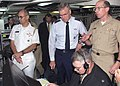US Navy 020730-N-3931M-008 The Chairman of the Joint Chiefs of Staff, Air Force Gen. Richard Myers (center) tours the Joint Air Operation Center aboard the U.S. Third Fleet command ship.jpg