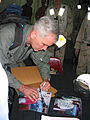 US Navy 030314-N-4964S-001 Marine Lt. Col. (ret.) and Fox News contributor Oliver North signs autographs for the crew of USS Tarawa (LHA 1).jpg