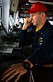 US Navy 030420-N-9964S-017 Lt. Cmdr. Scott Norr stands watch on the bridge and looks over the flight deck aboard USS Harry S. Truman (CVN 75).jpg