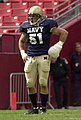 US Navy 031004-N-9693M-846 Navy linebacker Bobby McClarin played despite an injured left hand, which was bandaged.jpg