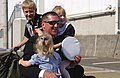 US Navy 031027-N-8937A-040 USS Juneau (LPD 10) Command Master Chief Tom Howard is greeted by his children following a three-month deployment.jpg