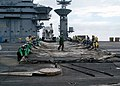 US Navy 040115-N-2198V-014 Sailors assigned to the air department aboard USS Carl Vinson (CVN 70) rig an emergency landing barricade.jpg