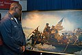 US Navy 040222-N-1522S-015 Personnelman 1st Class Larry Davis, of Rockhill, S.C., admires a painting in the museum aboard USS George Washington (CVN 73) during a celebration of President Washington's 272nd birthday.jpg