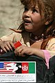 US Navy 040513-M-8683D-008 An Afghan girl carries school supplies given to her by U.S. Marines.jpg