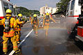 US Navy 040623-N-0000W-135 Firefighters from the Commander U.S. Naval Forces Japan Regional Fire Department respond at a mass casualty drill held at Yokosuka's Sullivans Elementary School.jpg