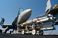 US Navy 040813-N-8704K-003 A weapons skid carrying 500-pound (GBU-12) laser guided bombs is staged on the ship's flight deck aboard USS John F. Kennedy (CV 67).jpg