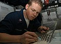 US Navy 040927-N-4565G-003 Aviation Warfare Systems Operator 2nd Class Jonathan Collins of Wildwood Florida, plots water space management for ships.jpg