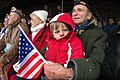 US Navy 041216-N-3236B-008 A young man keeps warm on his grandfather's lap during ceremonies held at the Mardassom Monument in Bastogne, Belgium.jpg
