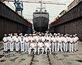 US Navy 050228-N-2445C-001 The crew Prestige forms ranks in front of the Osprey-class mine hunter coastal ship USS Raven (MHC 61).jpg