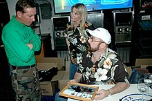 US Navy 050508-N-1205S-085 Television show American Hot Rod car builder Boyd Coddington and his wife Jo signed autographs for Sailors stationed aboard the nuclear-powered aircraft carrier USS Nimitz (CVN 68).jpg