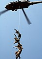 US Navy 050819-N-0716S-013 Members of the U.S. Navy Explosive Ordnance Disposal Mobile Unit Three (EODMU-3), Detachment 7, and Australia's Clearance Dive Team hang from a Suspended Personnel Insertion Extraction (SPIE) ri.jpg