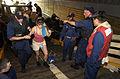 US Navy 050905-N-6436W-184 U.S. Navy Sailors help a New Orleans citizen up through the open well deck aboard the dock landing ship USS Tortuga (LSD 46).jpg