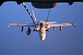 US Navy 050913-F-5480T-039 An F-A-18C Hornet refuels from a U.S. Air Force KC-10 Extender aerial tanker.jpg