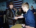 US Navy 051229-N-6484E-016 Country Music Singer Michael Peterson shakes hands with a crew member aboard the Nimitz-class aircraft carrier USS Theodore Roosevelt (CVN 71).jpg