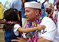 US Navy 060525-N-9643K-006 A Sailor greets his daughter on the pier following the return of the guided-missile destroyer USS Chung-Hoon (DDG 93) to Pearl Harbor after a four-month maiden deployment.jpg