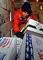 US Navy 061103-N-9723W-014 U.S. Navy Culinary Specialist Seaman Apprentice Willy Johnson performs an inventory check of frozen foods in a refrigerated storeroom aboard the Nimitz-Class aircraft carrier USS John C. Stennis (CVN.jpg