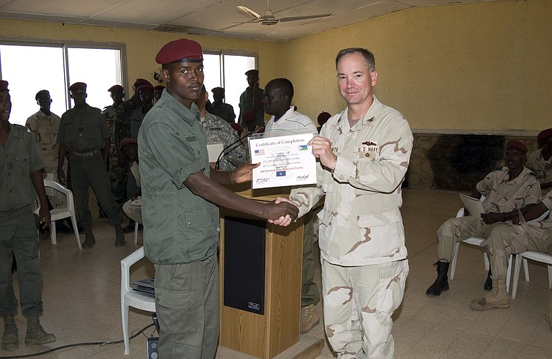 File:US Navy 061127-N-3884F-071 Captain John Q. Dal Santo, J9 Director, Combined Joint Task Force Horn of Africa, presents a counter-terrorism training completion certificate to Djiboutian army soldier Ibrahim Mohamed Kamil.jpg