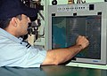 US Navy 070406-N-8655E-001 A Sailor aboard the USS Oklahoma City (SSN 723) familiarizes himself with the Voyage Management System (VMS).jpg