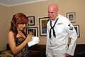 US Navy 070425-N-6536T-068 Intelligence Specialist 2nd Class Jarrod Fowler, assigned to USS Ronald Reagan (CVN 76), receives an autograph from Diane Degarmo (runner up in the 2004 American Idol season).jpg