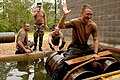 US Navy 070426-N-0553R-010 Lt. j.g. Christopher Casne, attached with Naval Mobile Construction Battalion (NMCB) 1, tries to maintain balance through a simulated river at the Leadership Reaction Course.jpg