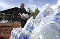 US Navy 070907-N-1810F-074 Amphibious assault ship USS Wasp crew members participating in Hurricane Felix disaster relief operations prepare water for delivery to local residents.jpg