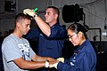 US Navy 070914-N-1786N-117 Sailors aboard amphibious assault ship USS Tarawa (LHA 1) perform a physical on a non-combatant during a non-combatant evacuation operation (NEO) drill.jpg