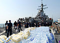 US Navy 080824-N-4044H-113 Sailors aboard the guided-missile destroyer USS McFaul (DDG 74) unload humanitarian supplies to be put on to pallets and then transported to the people of Georgia.jpg
