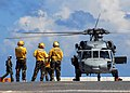 US Navy 080914-N-8132M-003 Aviation Boatwain's Mates (Handling) wait to launch an MH-60S Sea Hawk helicopter assigned to the.jpg