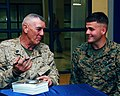 US Navy 081208-N-7862M-003 R. Lee Ermey, a retired Marine Corps gunnery sergeant and actor, left, signs an autograph for Lance Cpl. Jay Clayton.jpg