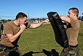 US Navy 090120-N-6484G-028 quipment Operator Constructionman Kenyon Clark and Builder Constructionman Justin Lieder practice techniques from the Marine Corps Martial Arts Program.jpg