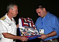 US Navy 090725-N-2354M-028 Vice Adm. William D. Sullivan presents Navy veteran Michael Yamarino a quilt of valor during the banquet of honor during the Returning Warrior Workshop in Atlanta, Ga.jpg