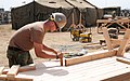 US Navy 091008-N-1424C-331 Builder 3rd Class Jeremy Morgan, assigned to Amphibious Construction Battalion (ACB) 1, helps construct a life support area (LSA) for 800 military personnel supporting Pacific Horizon 10.jpg