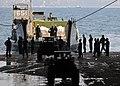 US Navy 100212-N-9950J-123 Sailors and Marines unload supplies aboard USS Essex.jpg