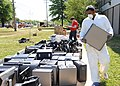 US Navy 100505-N-0659H-001 Aviation Ordnanceman 2nd Class Jarrod Snell, assigned to Navy Personnel Command, carries damaged computers from his work center during flood recovery operations.jpg