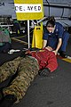 US Navy 100617-N-6362C-039 Hospital Corpsman 3rd Class Jodie Stump tends to a simulated casualty during a mass casualty drill aboard the Nimitz-class aircraft carrier USS Harry S. Truman (CVN 75).jpg