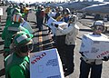 US Navy 101109-N-8744H-207 Sailors aboard the aircraft carrier USS Ronald Reagan (CVN 76) take boxes of supplies off a C-2A Greyhound from Fleet Lo.jpg