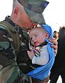 US Navy 101216-N-7084M-370 Chief Equipment Operator Michael Cincinati, assigned to Naval Mobile Construction Battalion (NMCB) 7, embraces his three.jpg