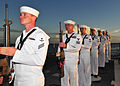 US Navy 110721-N-XR557-098 Members of the rifle squad aboard USS Chung-Hoon (DDG 93) conduct a gun salute during a ceremony commemorating the 44th.jpg